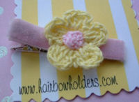 Crochet Flower Hair Clip - Yellow with Pink Center on velvet